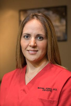women doctor with red scrubs